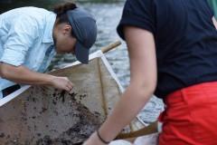 Amber Kivett pulls animals from the kick seine