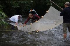 Jonathan Hartsell collects fish