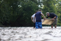 Mark Endries helps students with a kick seine